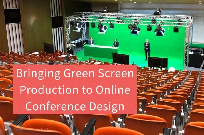view of a conference hall with two speakers in front of a green screen set up for an online conference